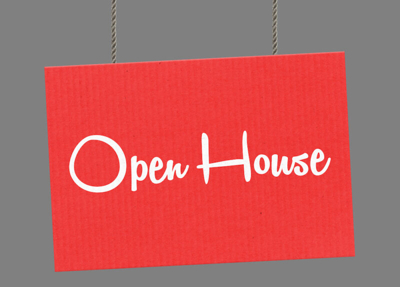 Open house sign hanging from ropes.