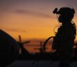 U.S. Army Sgt. Joseph Koszyk, a UH-60M Black Hawk helicopter crew chief with the New Jersey National Guard's 1-150th Assault Helicopter Battalion, prepares his aircraft for a night training mission at Joint Base McGuire-Dix-Lakehurst, N.J., Sept. 18, 2019. (U.S. Air National Guard photo by Master Sgt. Matt Hecht)