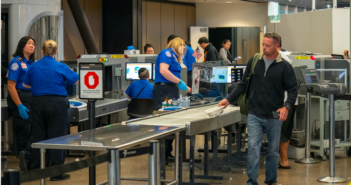 Seattle, WA AUGUST 26, 2018: Man passes though Transportation Security Administration TSA security checkpoint at Seattle-Tacoma International Airport. (Seattle, WA AUGUST 26, 2018: Man passes though Transportation Security Administration TSA security
