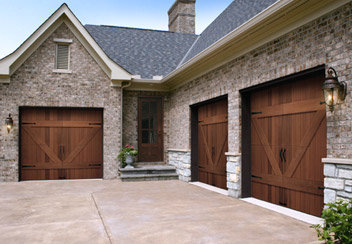 three garage doors on home