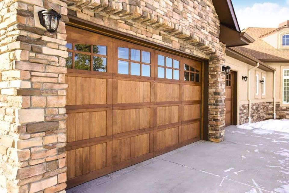 house with custom wood garage door