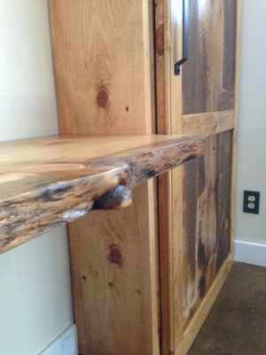 Custom bookshelf/ cabinet wall unit with sliding barn door and collapsible live edge desk
