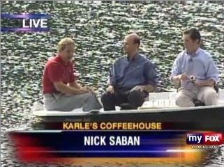 Alabama Coach Nick Saban praised Paul Finebaum. Here is a photograph of Saban with Finebaum and Rick Karle.