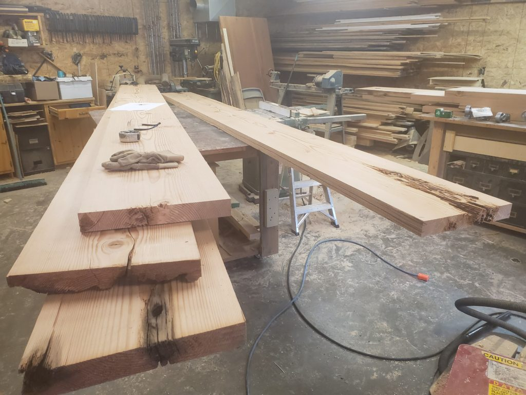 Slabs from 100 year old Doug Fir Beams for custom table being built by John Huisman
