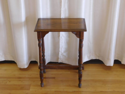Brown antique end table for rent
