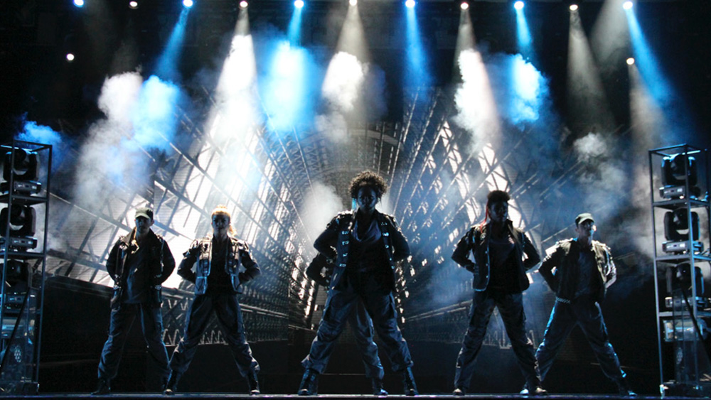 Dancers on stage with bright lights