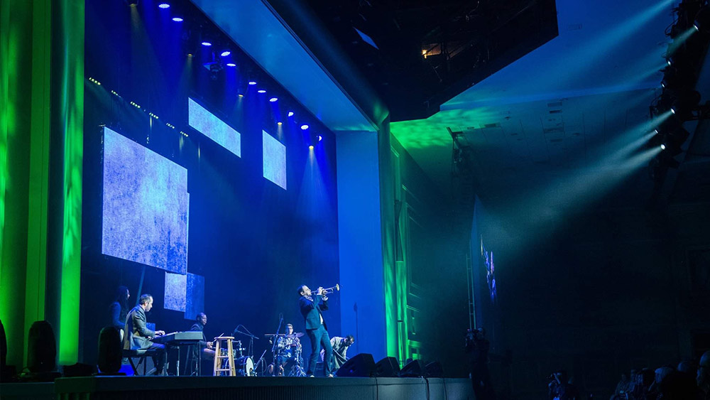 Modern Warrior performance on stage with multimedia screens