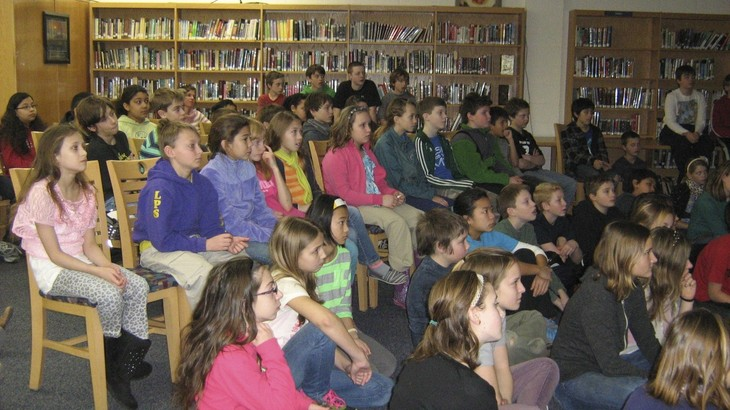 Students listening to Maggie read at Leland Public School