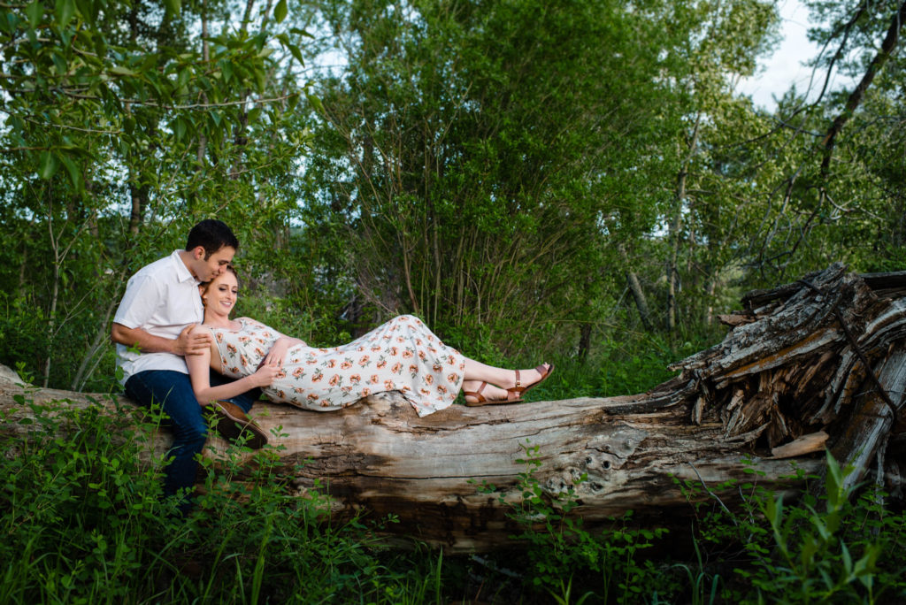 couple on a tree trunk