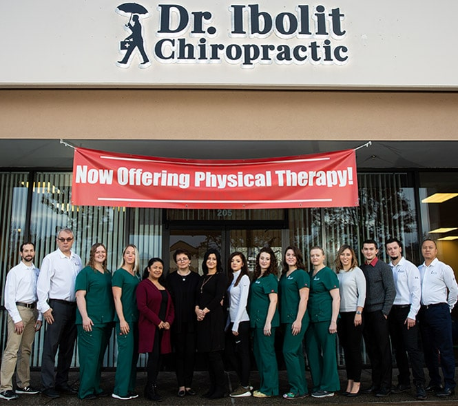 Dr Ibolit Chiropractic staff in front of the Vancouver WA office