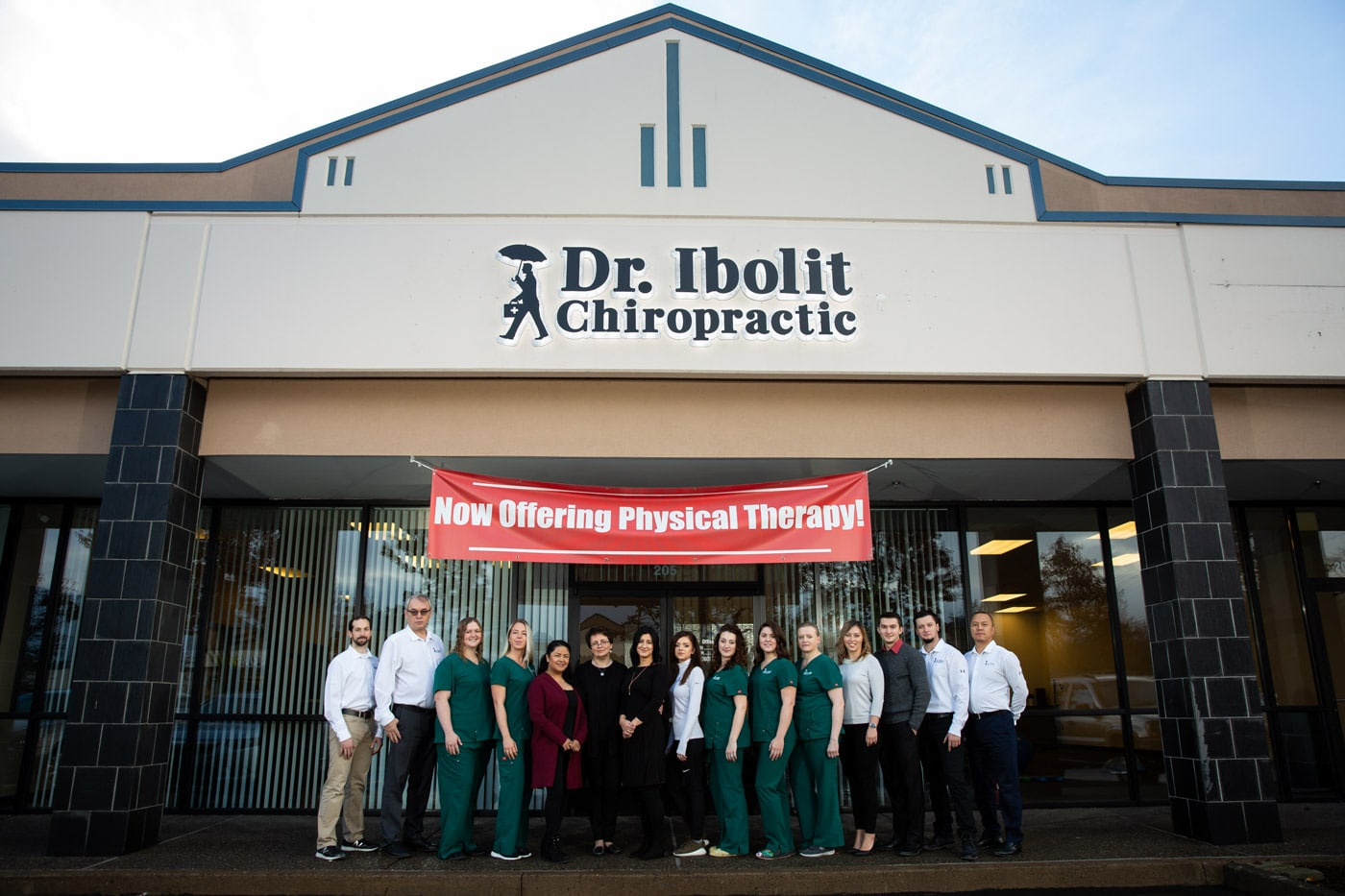 Dr Ibolit Staff in front of the chiropractic clinic in Vancouver WA