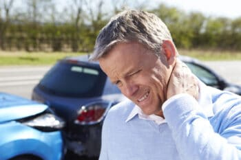 Man holding his neck after a car accident