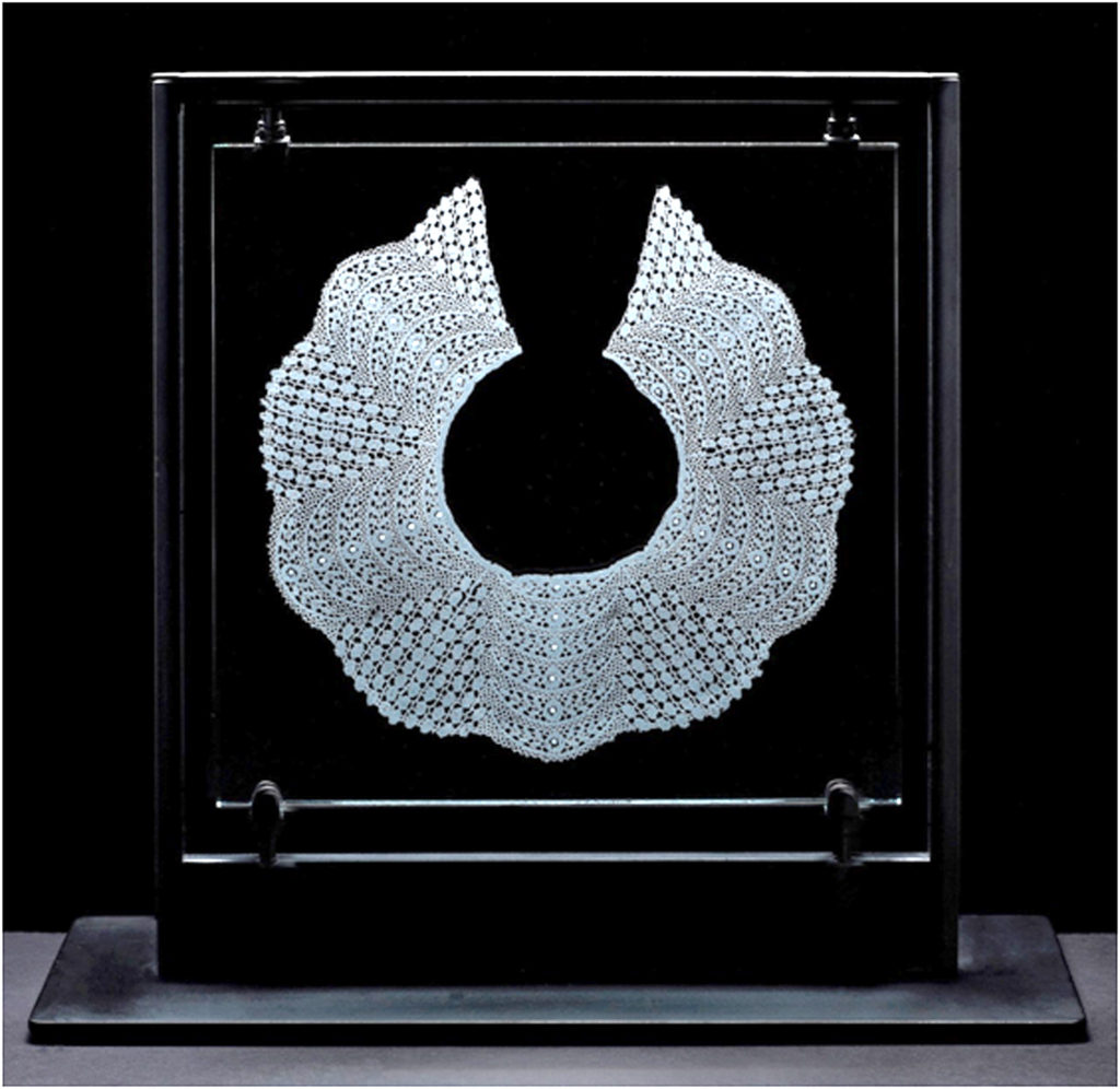 HONORABLE MENTION: Antique Lace Collar 5, Sandblasted-Engraved Glass in Stand by Barbara Atkinson - Size 17.5in x 18in x 7in (March 2017)