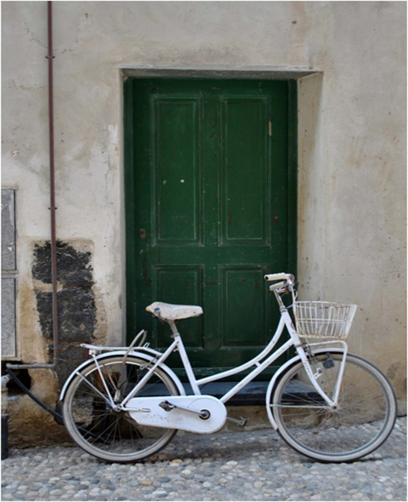 HONORABLE MENTION: White Bike, Photography by Lynne Smyers, 16in x 13in, $175 (February 2019)