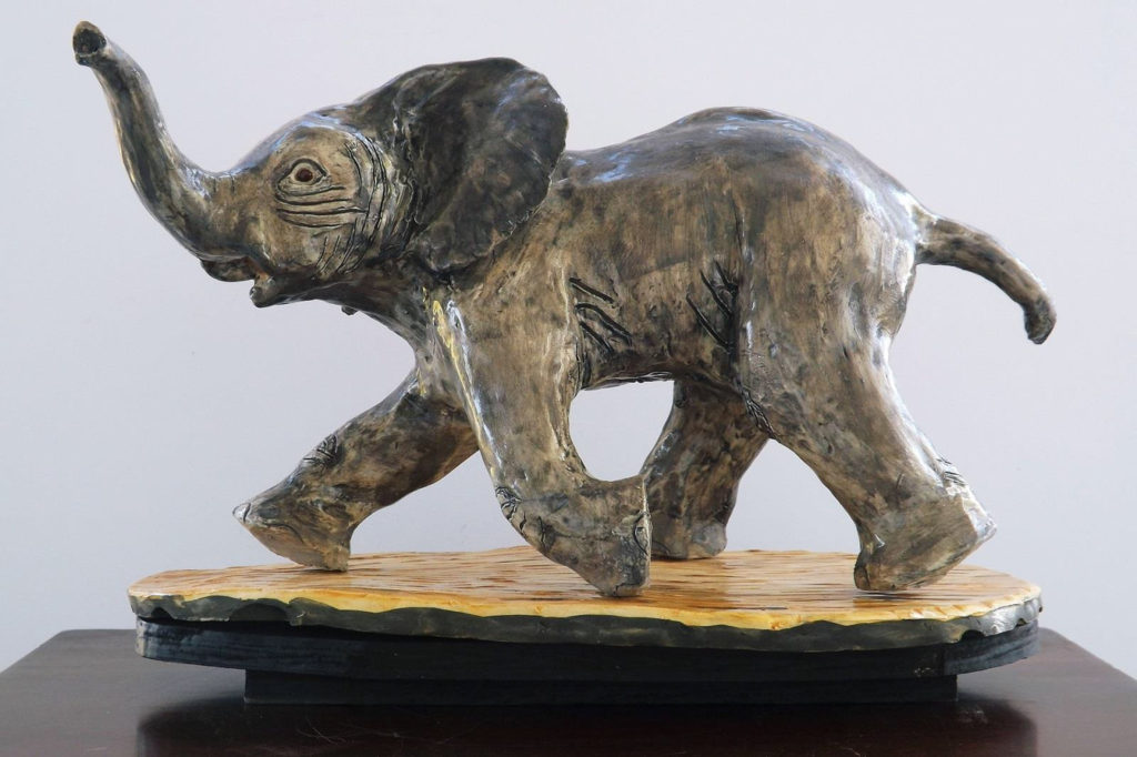 HONORABLE MENTION: Running for Survival, Porcelain Sculpture by Barbara Berne Smith, 9in x 15in x 7in, $1500 (March 2019)