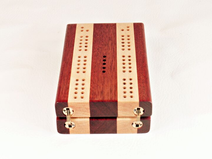 Bloodwood and Maple Compact Travel Cribbage Board showing the barrel hinges that are invisible when the board is opened.
