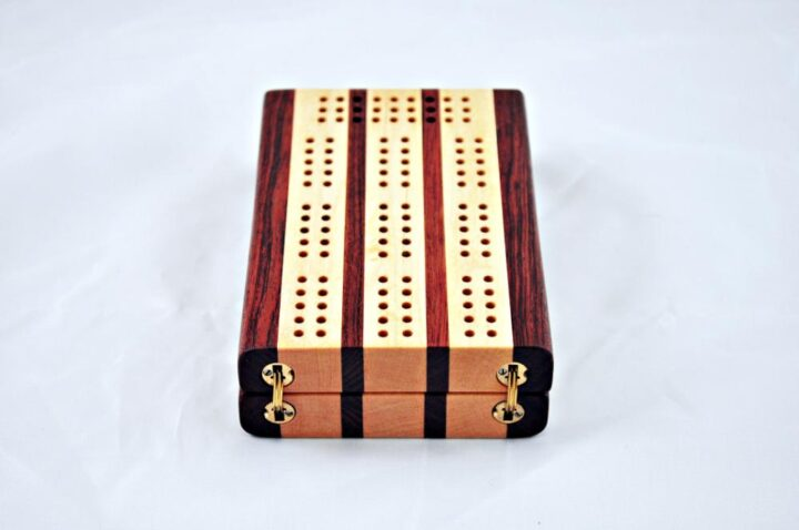 Bubinga and Maple 3 Player Travel Cribbage Board. showing the hinges that are completely hidden when the board is being played.