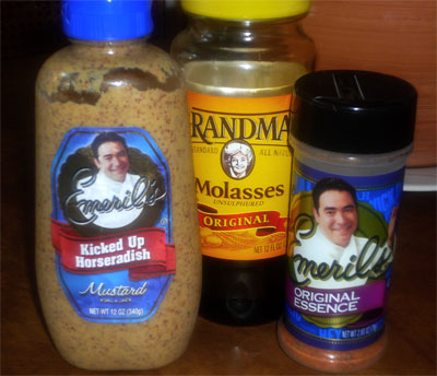 Emeril's smiling face on his products