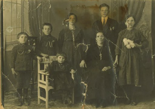 Alfredo Morelli, age 7, is the first child on the left. Seated are his sister and his mother.