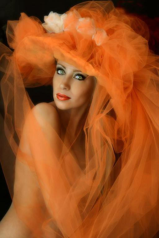 """""""Orange hat"""", splendid monochrome portrait ... Orange color, a beautiful face... It won gold medal in USA and in Macau and many honorable mentions ... typical Fairy Tales Beauty."""
