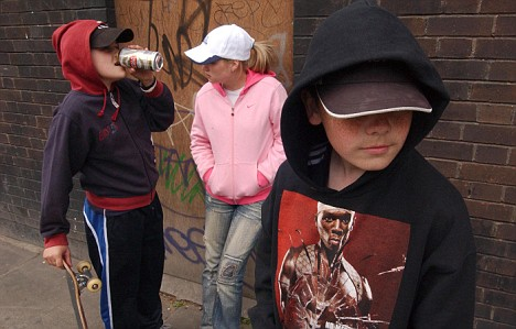 Photo by CHRIS GORMAN: Hooded youth