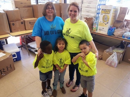Very young volunteers who assisted with the unloading and distribution of the supplies in Texas.