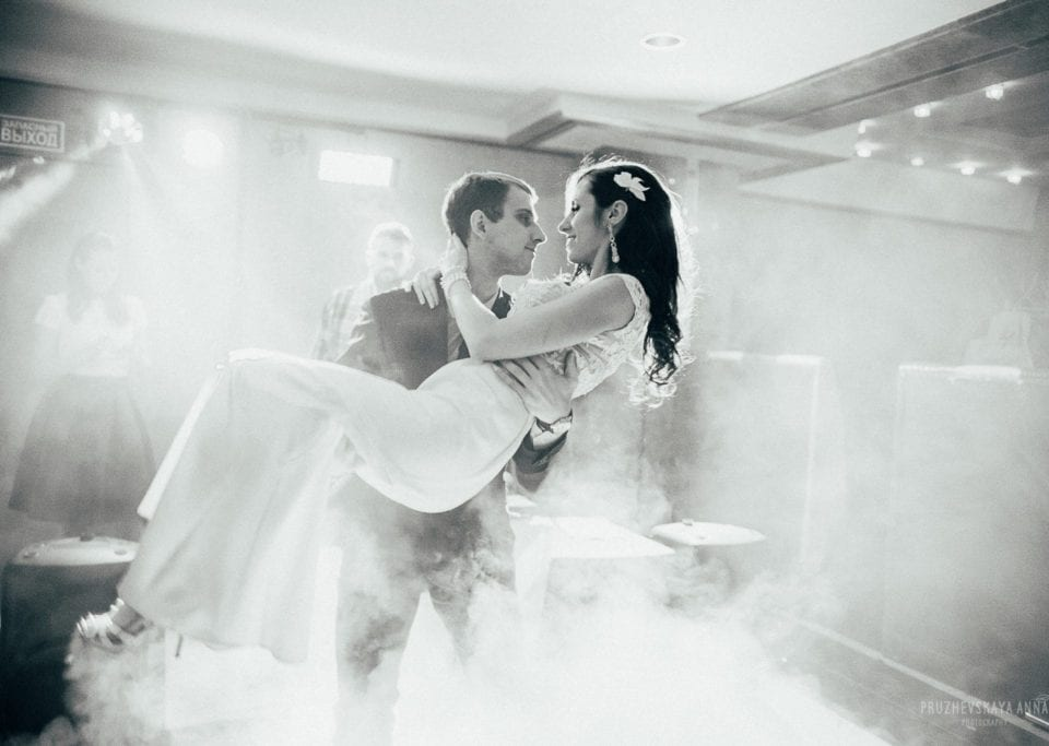 Bride and groom first dance with fog in Black And White