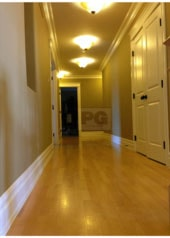 The second floor hallway corridor was painted in a light gray paint colour