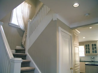 painted hallway with white stair posts and light gray walls