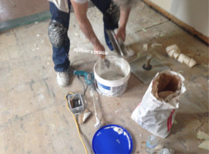 painter preparing drywall repair compounding mix before painting