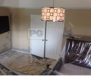 drop cloth protects floor in a room before painters start painting