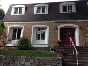 shows painting exterior windows in white paint and red door with brick on house in Ottawa Rockcliffe area by painters PG PAIINT & DESIGN