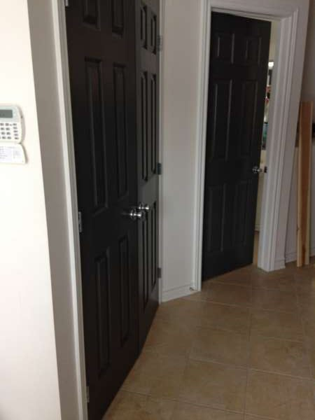 interior painting with white paint colour on walls and painted black doors by PG Paint & Design painters in Ottawa