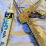 acrylic-latex caulk and caulking gun used by painters to seal gaps before painting