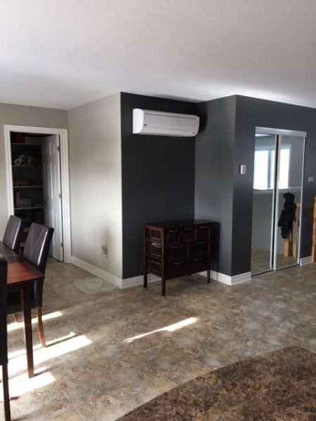 dining room painted in revere pewter with entrance in kendall charcoal paint by house painters in Ottawa PG Paint & Design