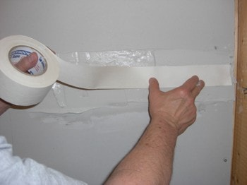 drywall tape applied over mudding to repair walls before painting