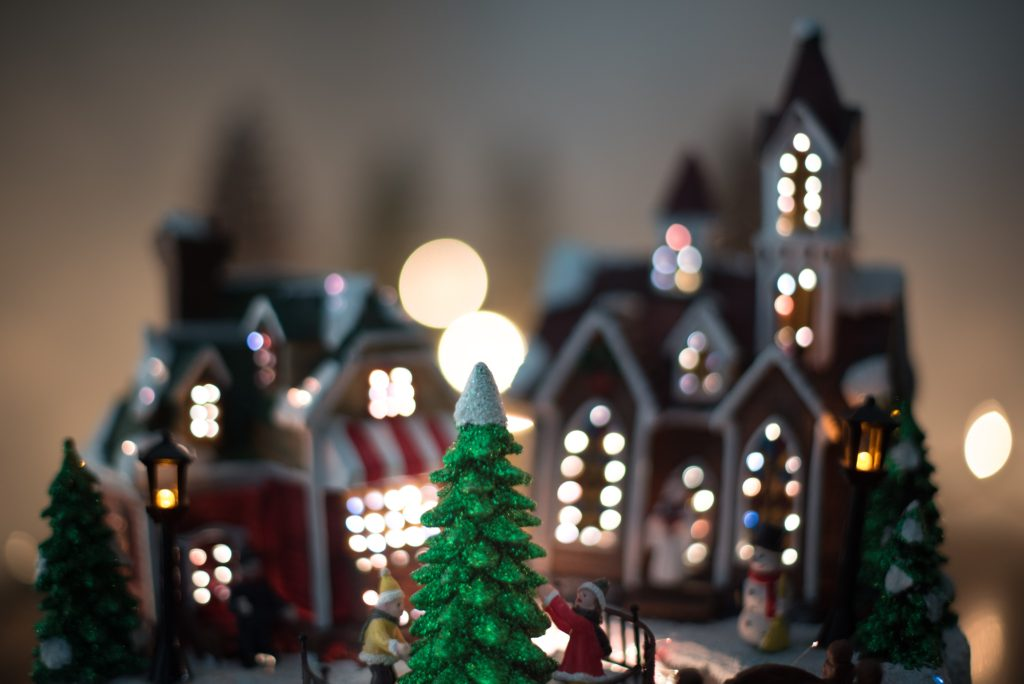 gingerbread house decorated with lights adds colour to home decor