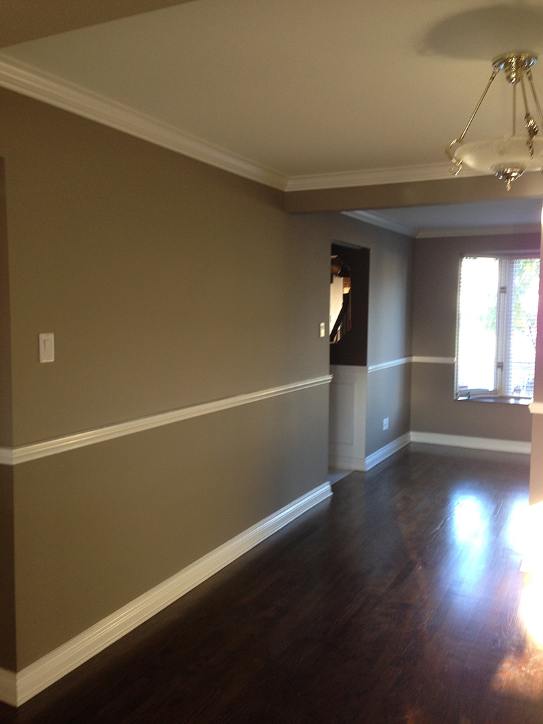 dining and living room areas painted in dark gray colour by PG PAINT & DESIGN