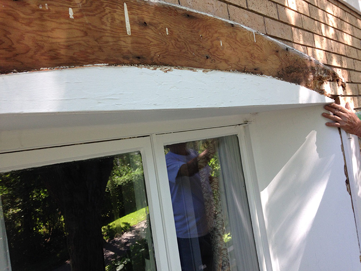 exterior wooden decor installed above the painted window
