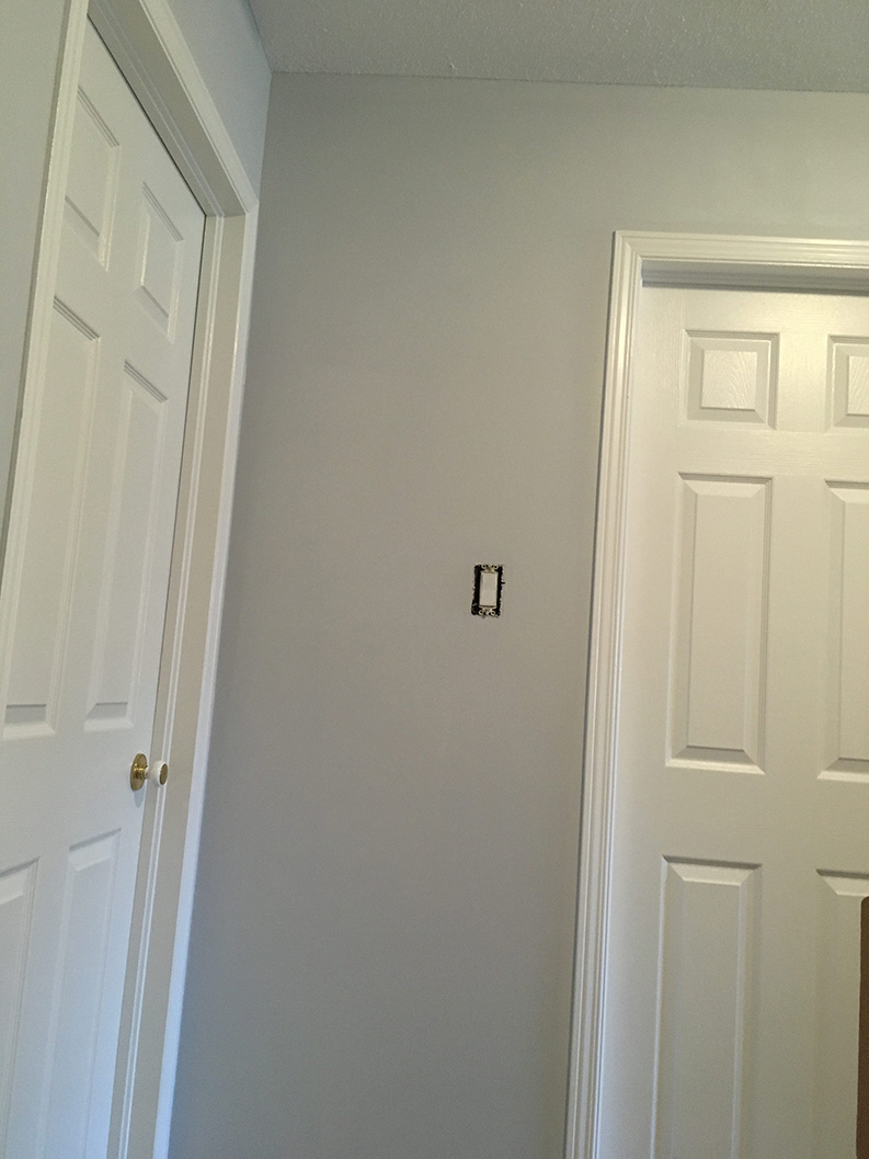 hallway painted in gray colour by PG PAINT & DESIGN