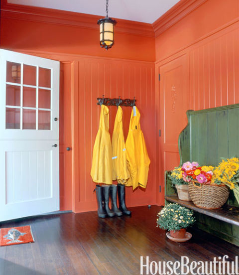 living room painted in red colour by PG PAINT & DESIGN