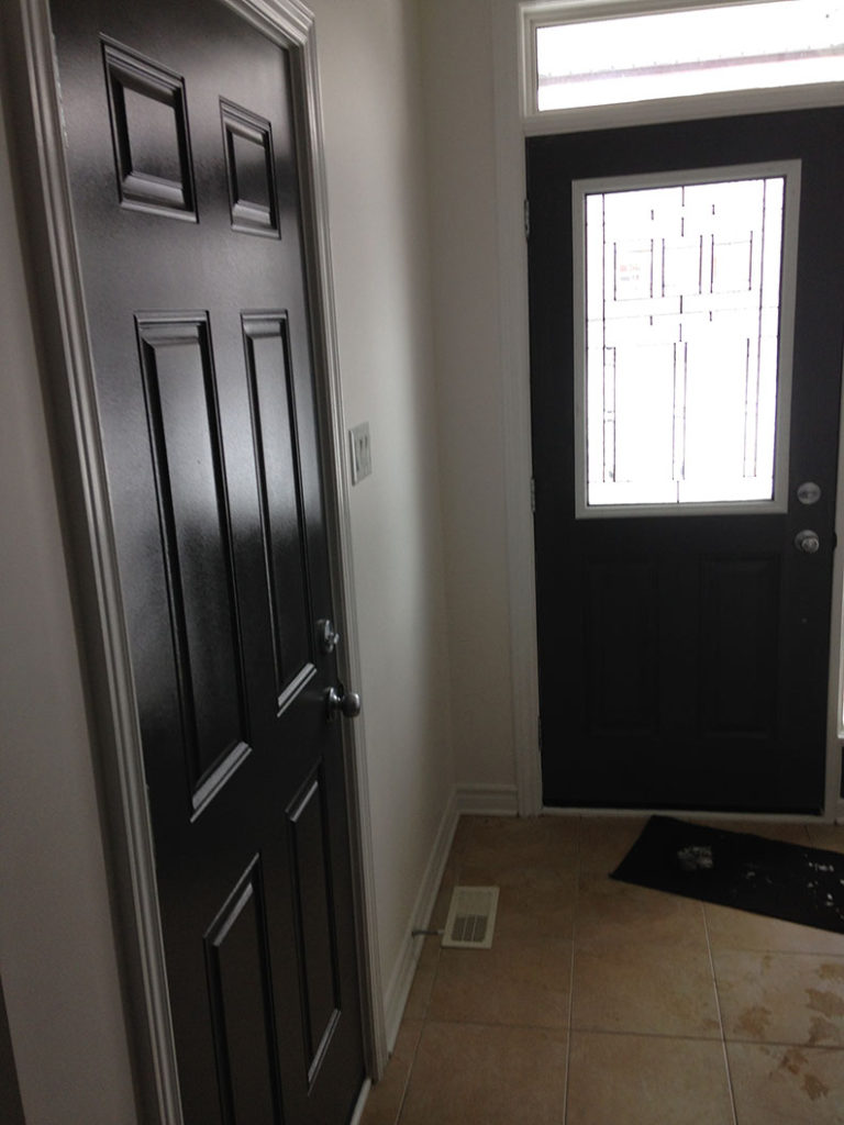 interior painting of doors in dark paint colour painted by PG PAINT & DESIGN painting company in Ontario Ottawa