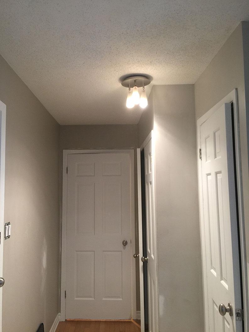 painting of hallway corridor with doors