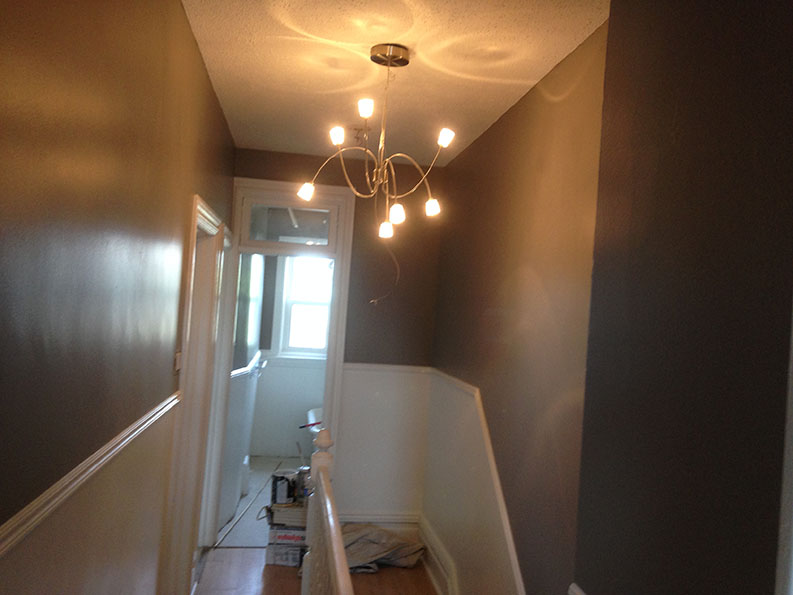painting of hallway done by painting company PG PAINT & DESIGN in apartment