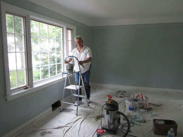 Pino owner of PG PAINT & DESIGN painting interior of house in Ontario Ottawa