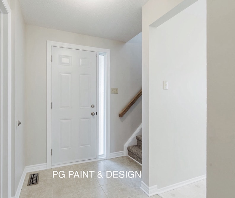 professional painted entrance with door and stairway by painting company in Ottawa