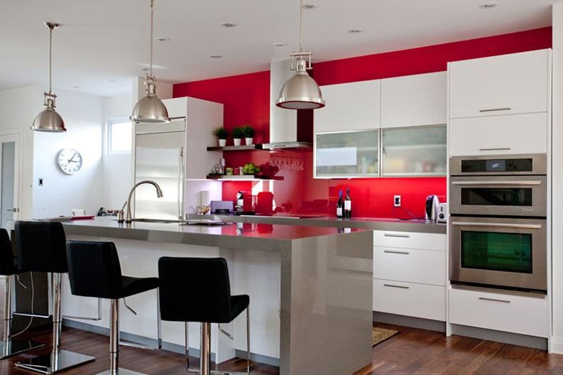 red paint on focal wall of kitchen in Dovercourt area inside a house painted by PG PAINT & DESIGN Ottawa painters