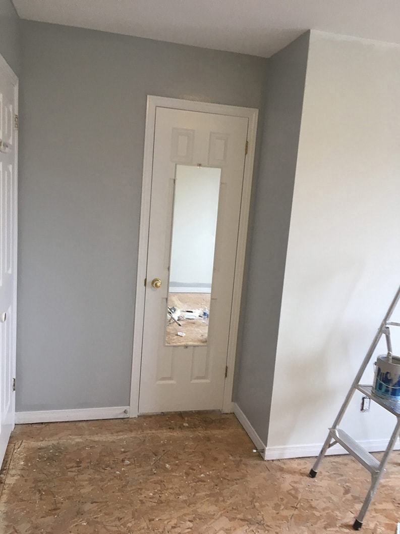 interior walls of the room painted in gray colour by PG PAINT & DESIGN