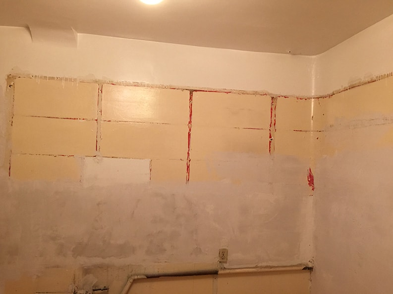 unpainted interior wall before painting with drywall patching and repair
