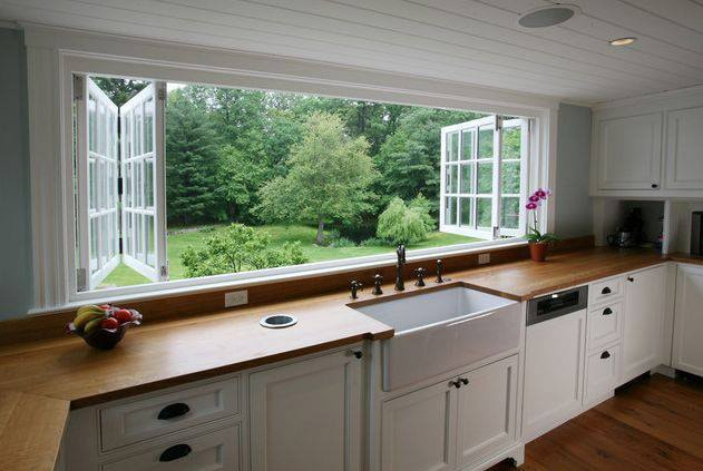 interior painting of kitchen with a view of a garden from inside